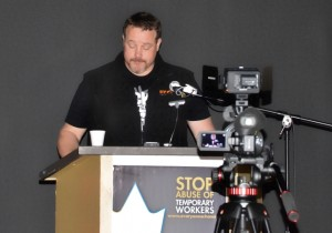 IUOE Local 115 Member Representative Brian LeFebvre addresses the crowd at a rally held to support foreign Tim Horton's workers subjected to employer abuse.
