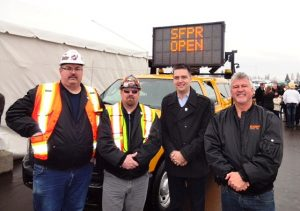 Local 115 President Wayne Mills, Brother Brett Chapman, B.C. Transport Minister Todd Stone and Local 115 Business Manager Brian Cochrane at the official opening of Highway 17, the South Fraser Perimeter Road.